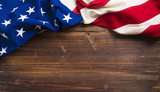 Old American Flag on wooden plank background - 90077739