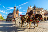 Horse carriages at main square in Krakow - 90084388