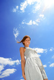 woman against cloudy sky - 90115905
