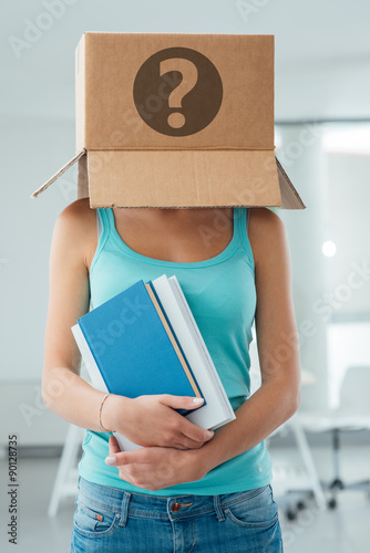 Insecure female student with a box on her head Poster