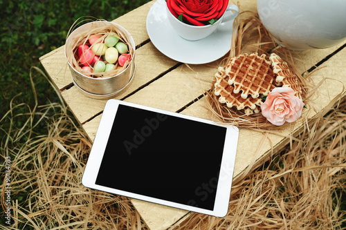 Deurstickers Klaar gerecht Top view digital tablet lying on wooden box with cookies, flower