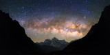 Bowl of Heavens. Bright and vivid Milky Way galaxy over the snowy mountains. Beautiful starry night sky seems to be in a