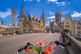 Blue sky over Gent, Belgium, with a traditionally decorated bicycle in the foreground - Fine Art prints