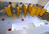 small toilets and sinks in the bathroom of the kindergarten