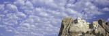 Panoramic image with white puffy clouds behind Presidents George Washington, Thomas Jefferson, Teddy Roosevelt and Abraham Lincoln at Mount Rushmore National Memorial, South Dakota - 90208316