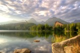 Beautiful lake in mountains. Strbske Pleso Lake at sunset in High Tatra Mountains, Slovakia.