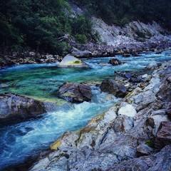 Water stream with rocks © nickimpression