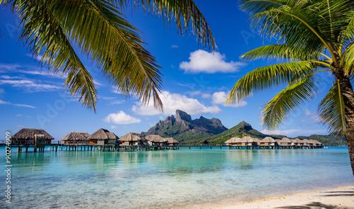 fototapeta na ścianę Bora Bora framed by palm trees
