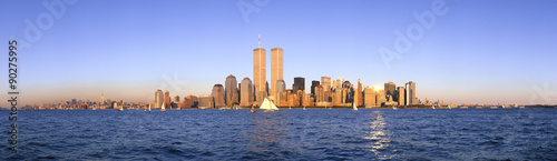 Panoramic view of sailboat on the Hudson River, lower Manhattan and New York City skyline, NY with World Trade Towers at sunset