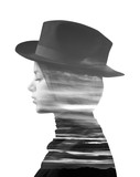 Double exposure of girl wearing hat and sunset monochrome