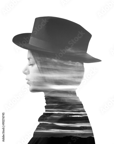 Double exposure of girl wearing hat and sunset monochrome - 90276745