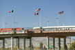 International border of Mexico & the United States, with flags and walking bridge connecting El Paso Texas to Juarez, Mexico