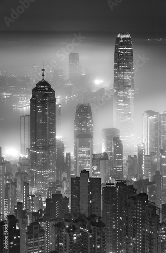 Misty night view of Victoria harbor in Hong Kong city