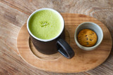 Close up hot Greentea matcha latte wood background poster