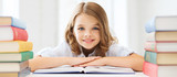 Fototapety smiling little student girl with many books