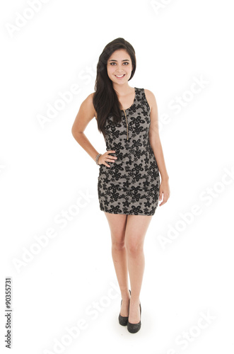 Beautiful young woman wearing a little black dress posing Poster