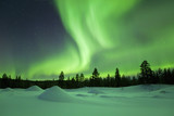 Fototapety Aurora borealis over snowy winter landscape, Finnish Lapland
