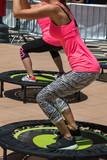 Fototapety Pretty Girl doing Fitness on Mini Trampoline