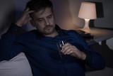 Miserable man drinking alcohol poster