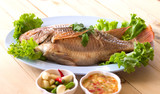 fish.steamed fish chinese style on wooden