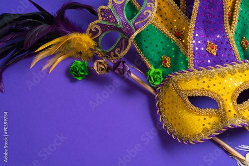 Mardi Gras or carnival mask on purple background
