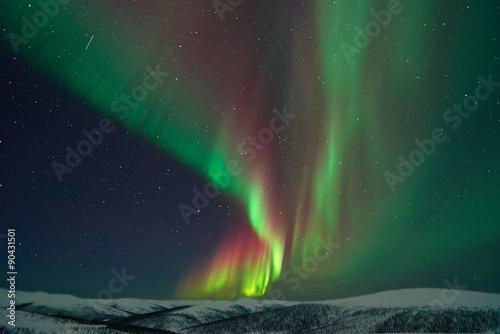 Canvas Noorderlicht Aurora Borealis and meteors in Alaska