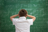 Fototapety Schoolboy have problem with  formulas