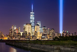 New York City Tribute in Light. The annual commemoration of September 11th in Lower Manhattan adjacent to the new World Trade Center. Two vertical columns of light rise above the Financial District. - 90478508