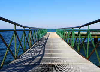 Pier at the sea with green railing © dalaxey