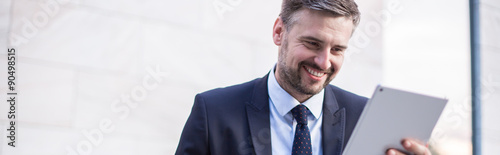 Happy businessperson with tablet