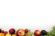 Fresh fruits border on white background with copyspace