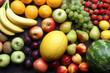 Fresh mixed fruits background on kitchen table