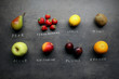 Different fruits on kitchen table with chalk signs