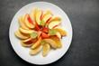 Fresh fruit pieaces on white plate