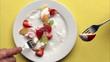 Eating fresh fruit snack with yoghurt - healthy food,  timelapse
