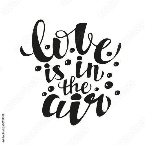 Hand lettering calligraphic typography poster.Romantic quote 'Love is in the air'.For greeting cards, postcards, posters, t-shirts and other decorations.Vector illustration