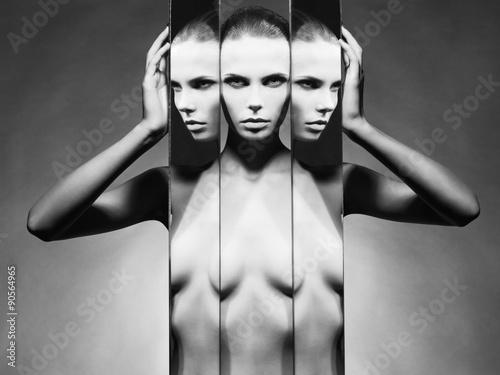 Woman and mirrors плакат