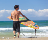 Portrait of Surfer with longboard