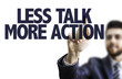 Business man pointing the text: Less Talk More Action