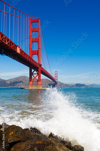 Poster Golden Gate Bridge with spray from ocean wave - in San Francisco