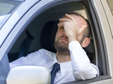 Stressed and angry driver in his car
