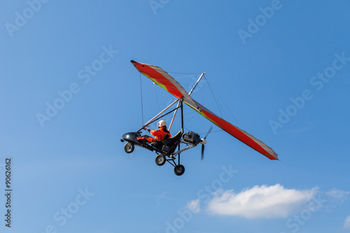 Fototapeta The motorized hang glider over the ground
