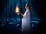 Elven girl with fire in night forest poster