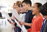 Fototapety Group Of School Children Singing In Choir Together