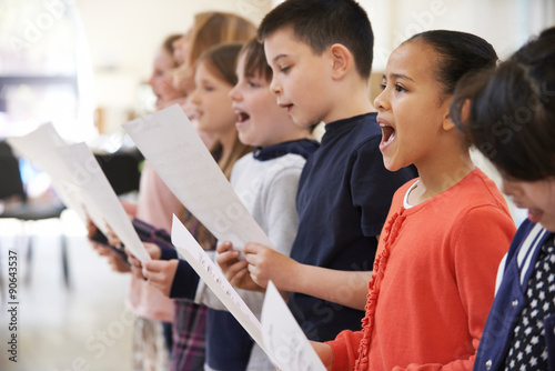 Fototapeta Group Of School Children Singing In Choir Together