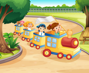 Children riding on the train in the park