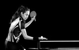 Fototapety Young pretty sporty girl playing table tennis