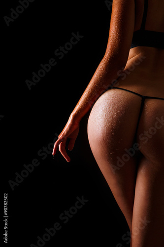 Plagát Sexy wet butt girls in underwear over black background