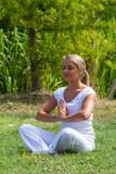 zen 20s blond girl revitalizing herself,park surroundings poster