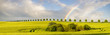 Obrazy na płótnie, fototapety, zdjęcia, fotoobrazy drukowane : Wielobarwna tęcza po przejściu ulewy nad polem